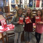 Students posing with books.