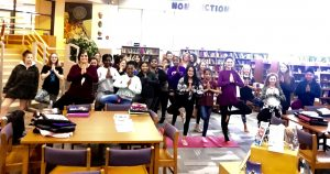 Students doing yoga in the library.