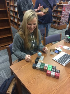 A teacher playing with cubelets.